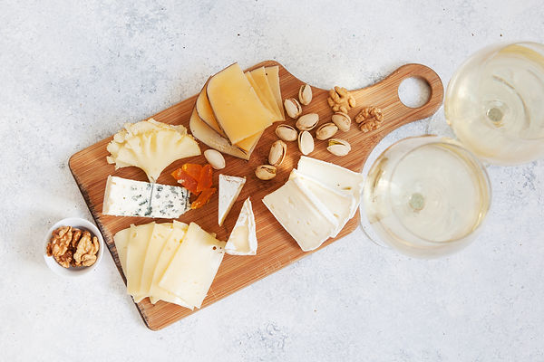 Cheese plate served with white wine, cra