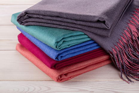 Neatly stacked piles of cashmere stoles,