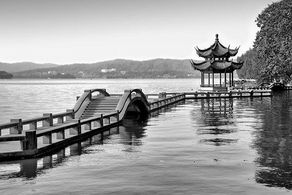 MJFC in Hangzhou China bridge and pagoda on water