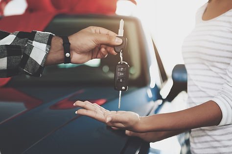 Close up man is giving keys to woman. Af