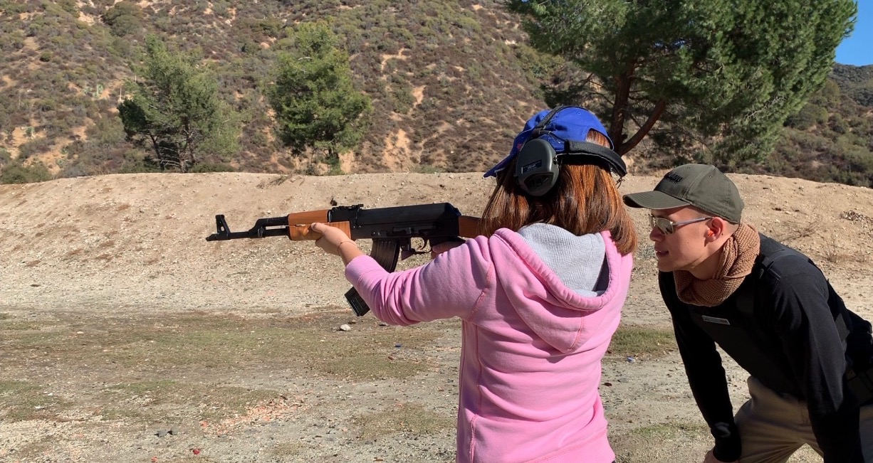 A mom of two shooting AK-47 rifle