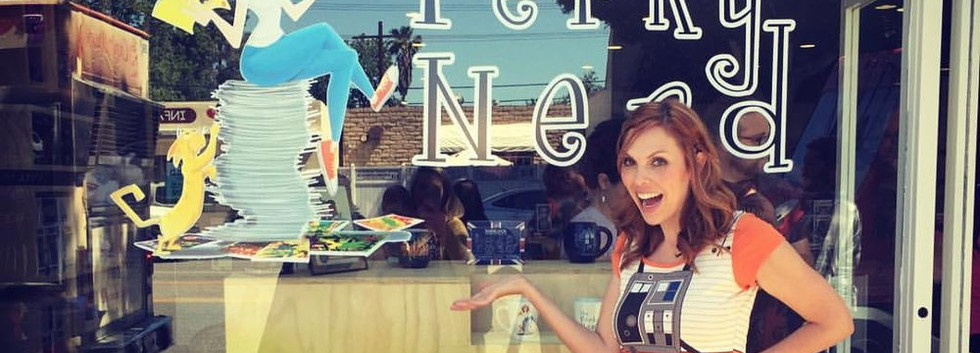 Owner of shop and her new window art