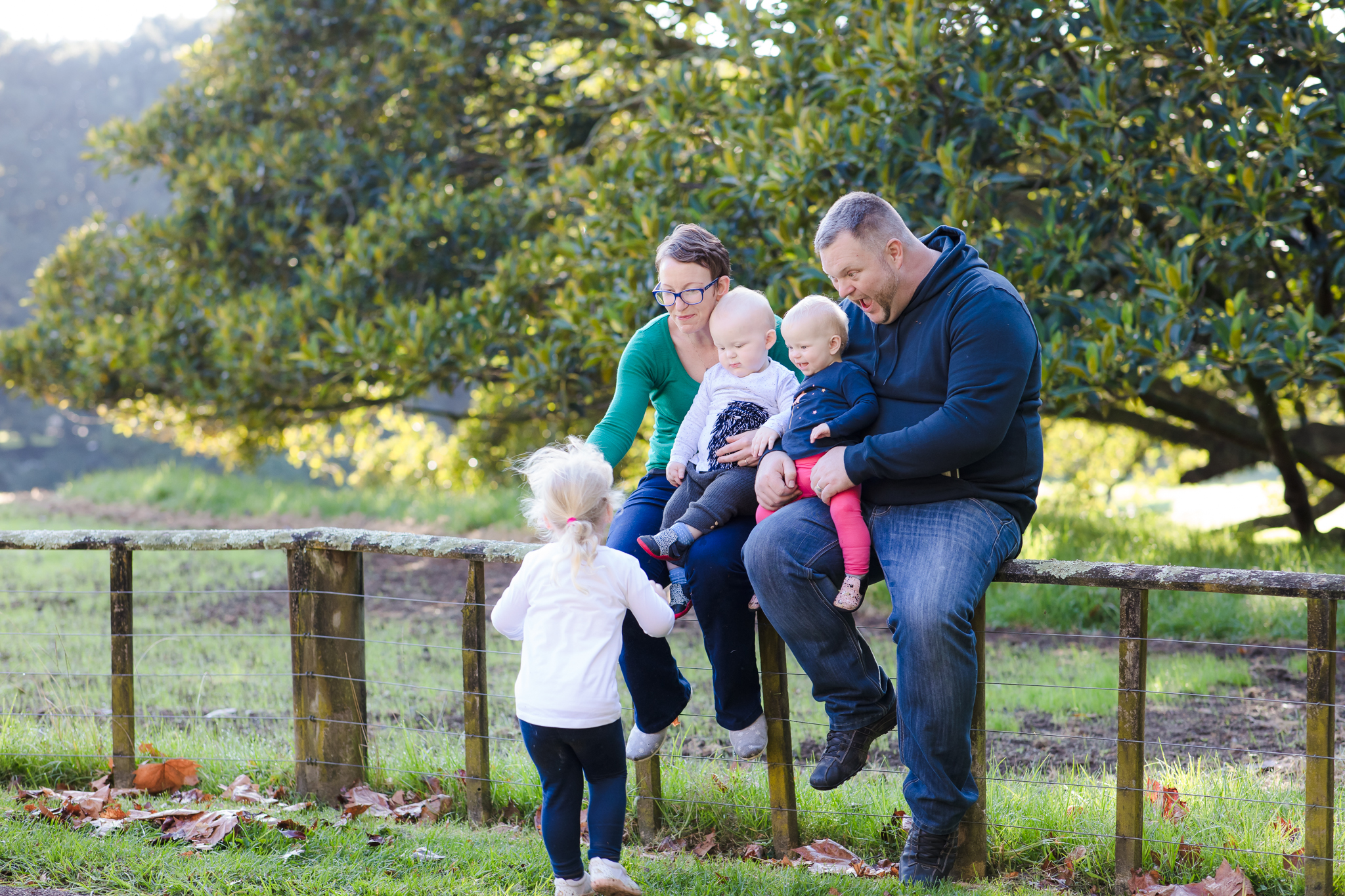 Family of five on a fence at Cornwall Park, Auckland by Janine Fox photography