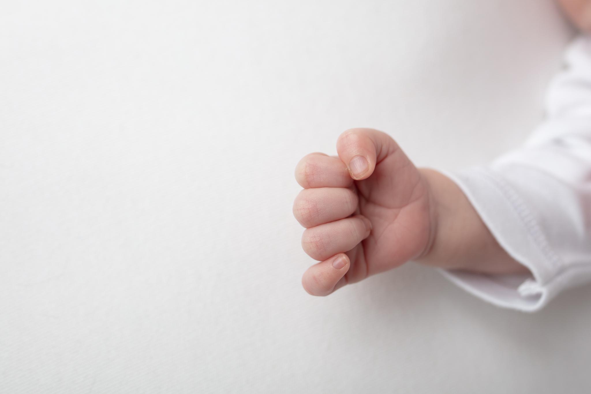 Newborn baby's tiny hand