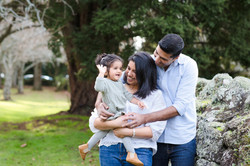 Parents holding and looking at their toddler by Janine Fox photography