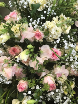 Coffin spray with Roses and Freesias
