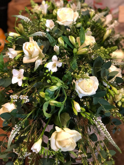 Roses and Freesias in greens and whites