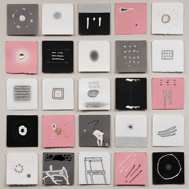 A series of white, grey, and pink cloth squares depicting the artist's interpretation of femininity.