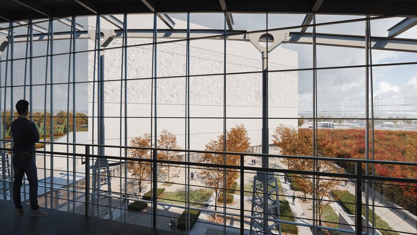 Vue des espaces de travail du 5e  étage du Centre de préservation actuel, vers la cour et la façade sud-est de la nouvelle installation