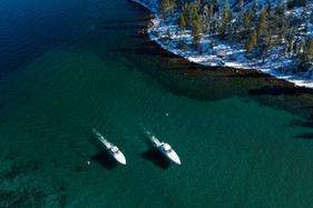 Emerald Bay Aerial both boats in channel