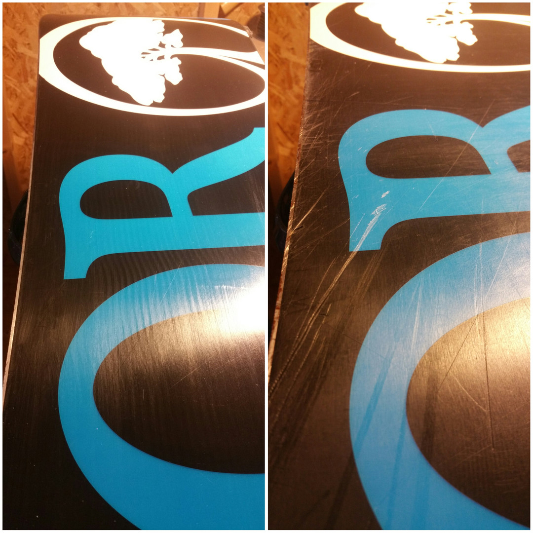 Snowboard base before and after belt grind and wax