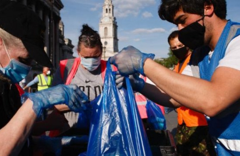 Volunteers outside holding plastic bags - Dean Russell MP Watford