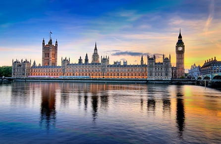 Image of the Houses of Parliament in a scene across the Thames