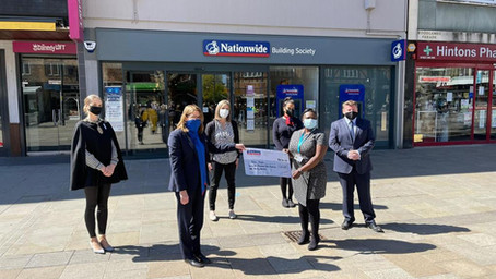 Watford's MP presents cheque to local charity