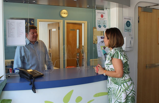 Dean Russell MP working a shift at a local business in Watford listening to local views