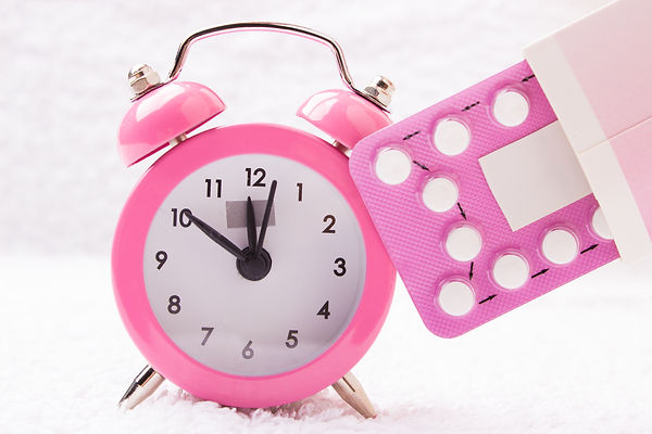 Alarm Clock And Contraceptive Pills.jpg
