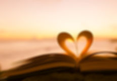 Heart from a book page against a beautif