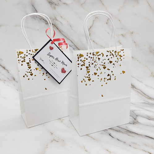Small paper gift bag with golden hearts