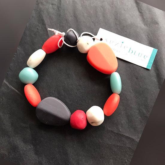 Coral, blue & white stone effect bracelet
