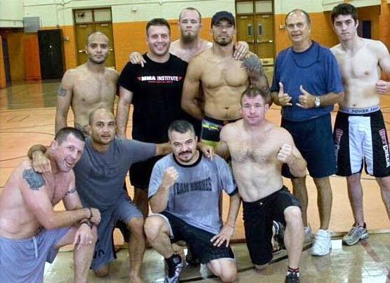 Pat Miletich, BJ Penn, Matt Pena, Matt Hughes, Amir Khillah, Tony Zucca, Jeremy Horn, Damarquis Johnson, Mr. Penn, and Jessi Martin after a training session.