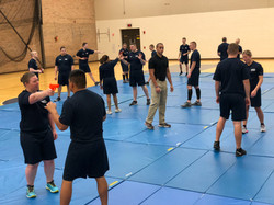 Senior instructor working with police cadets