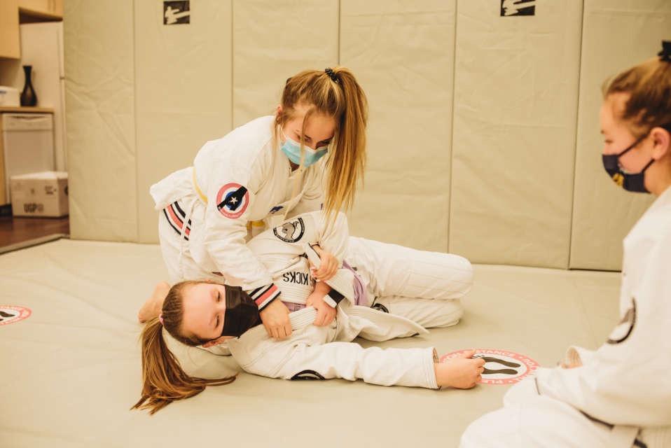 Three female students learning Jiujitsu at Lightning Kicks