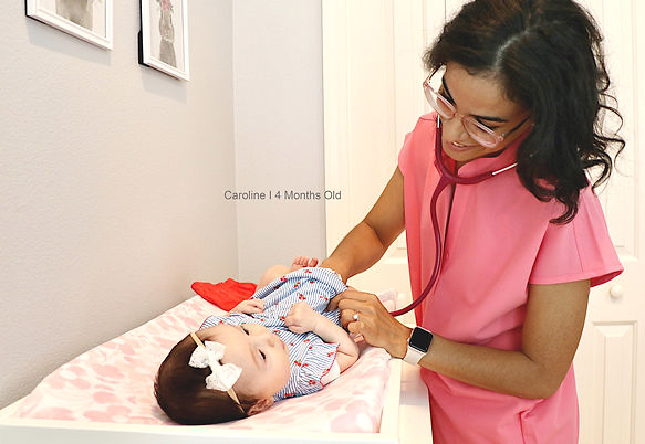 Dr. Lastra with baby doing physical exam I House Call Pediatrician St Pete