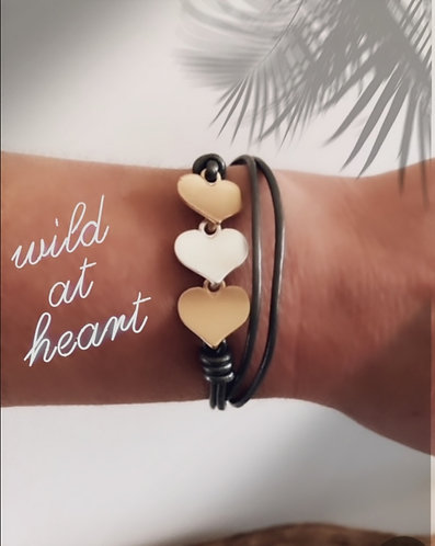 Multi tone layered heart on leather bracelet