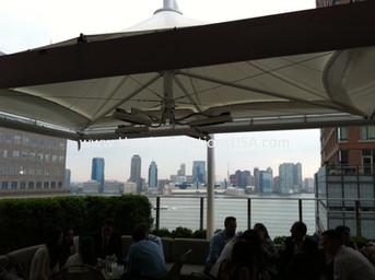 Solaira SCOSY XL under umbrella Conrad Hotel bar