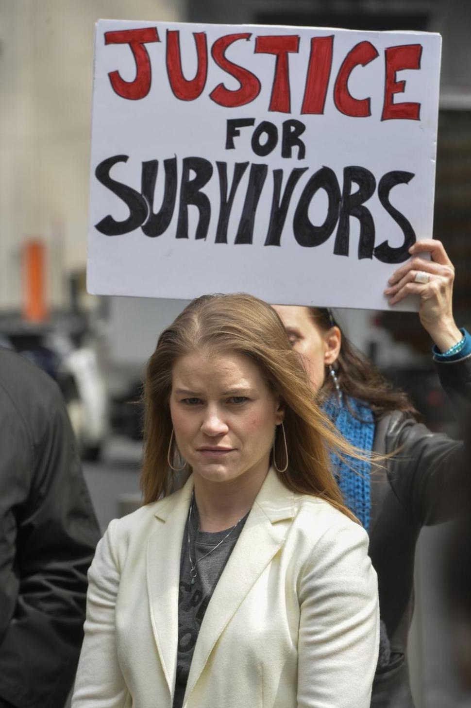 survivor sign in background
