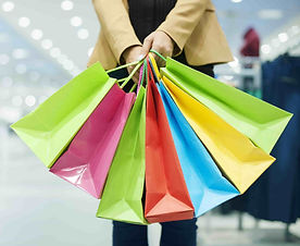 woman-with-shopping-bags-min_edited-min.