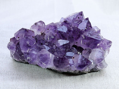 Amethyst cluster - width 120mm by 50mm high by 80mm deep