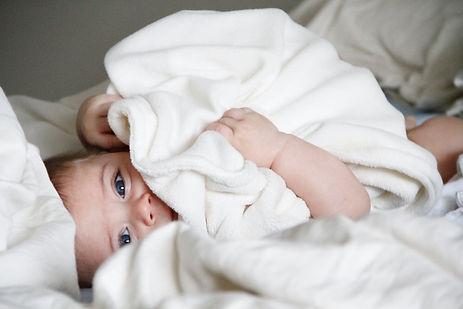 Happy baby snuggling blanket
