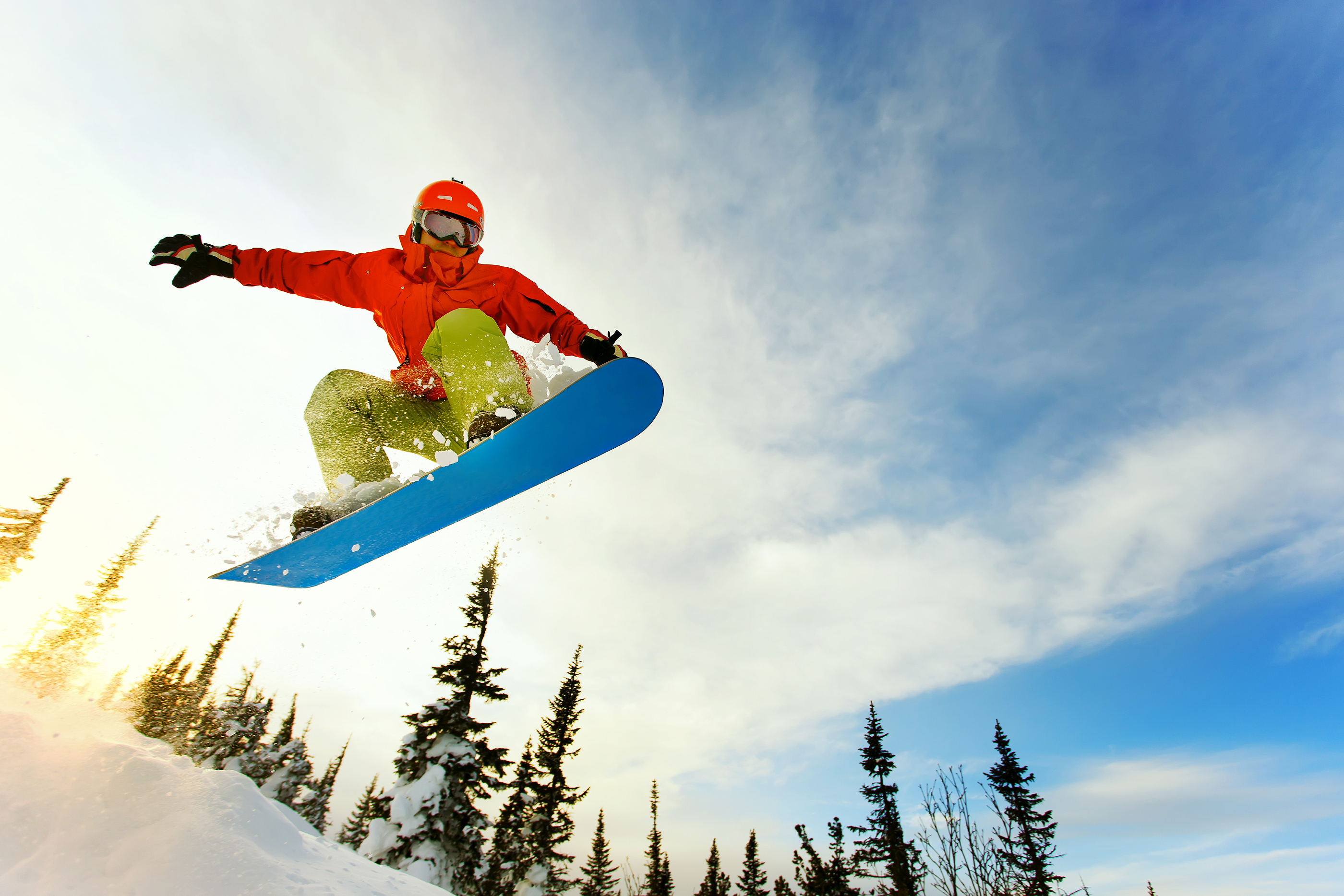 Snowboarder jumping through air with deep blue sky in background.jpg