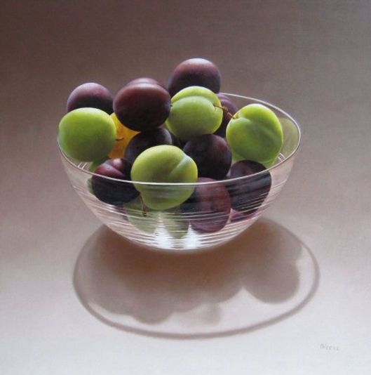 Glass bowl with plums