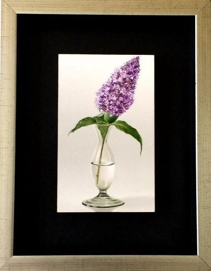 Vaasje met  paarse bloem