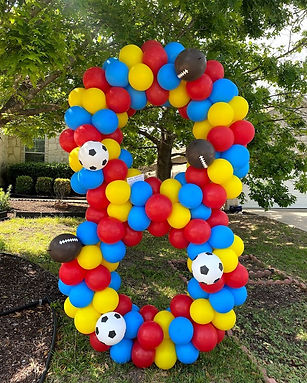 multicolor yard balloon number 8 with soccer and football balloon in austin