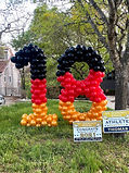 red orange and black yard balloon number 18 in houston