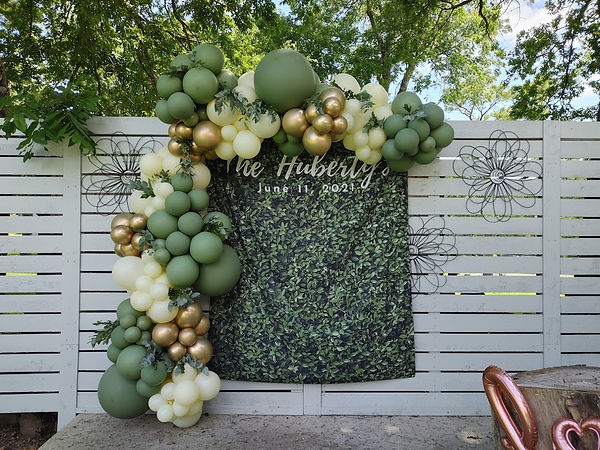 green and gold balloon garland at wedding in houston