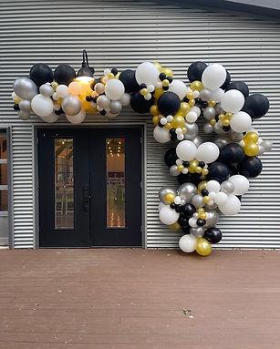 austin black and gold balloon garland.jpeg