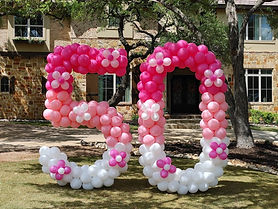 pink and white yard balloon numbers 50.j