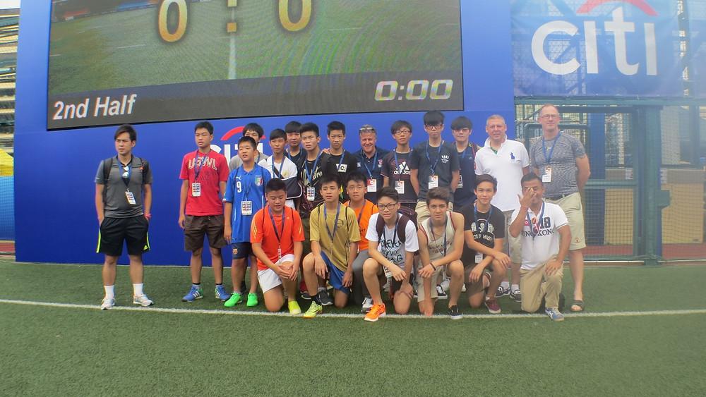 Tournament Director of the Hong Kong Football Club Soccer 7's, Tony Bratsanos (centre) along with Breakthrough director Matt Lindsay coach Ah Sa on the pitch at the Hong Kong Soccer 7's