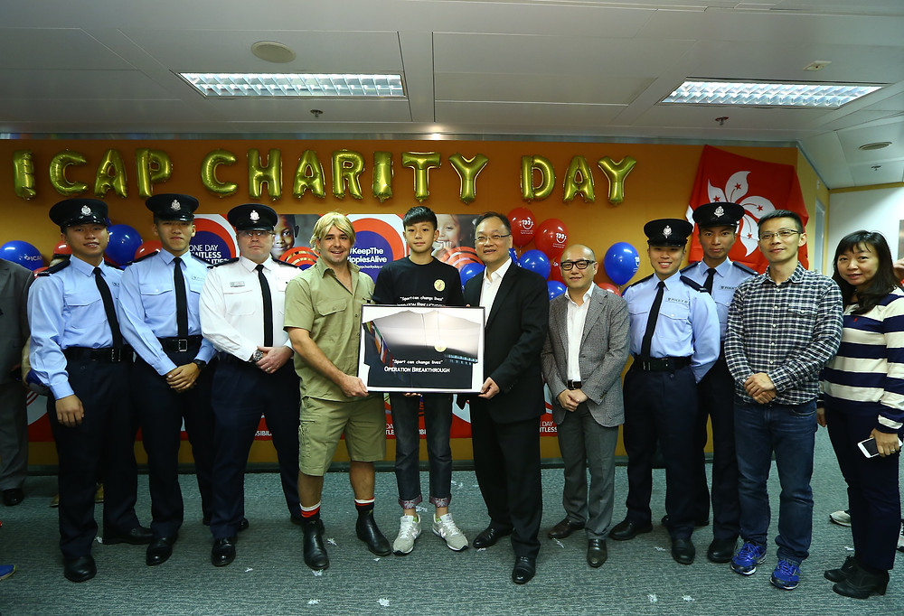ICAP Charity Day 2014 shirt presentation to CEO Benny Luk (centre right) Anthony Walsh COO  (centre left)- Dec 3, 2014