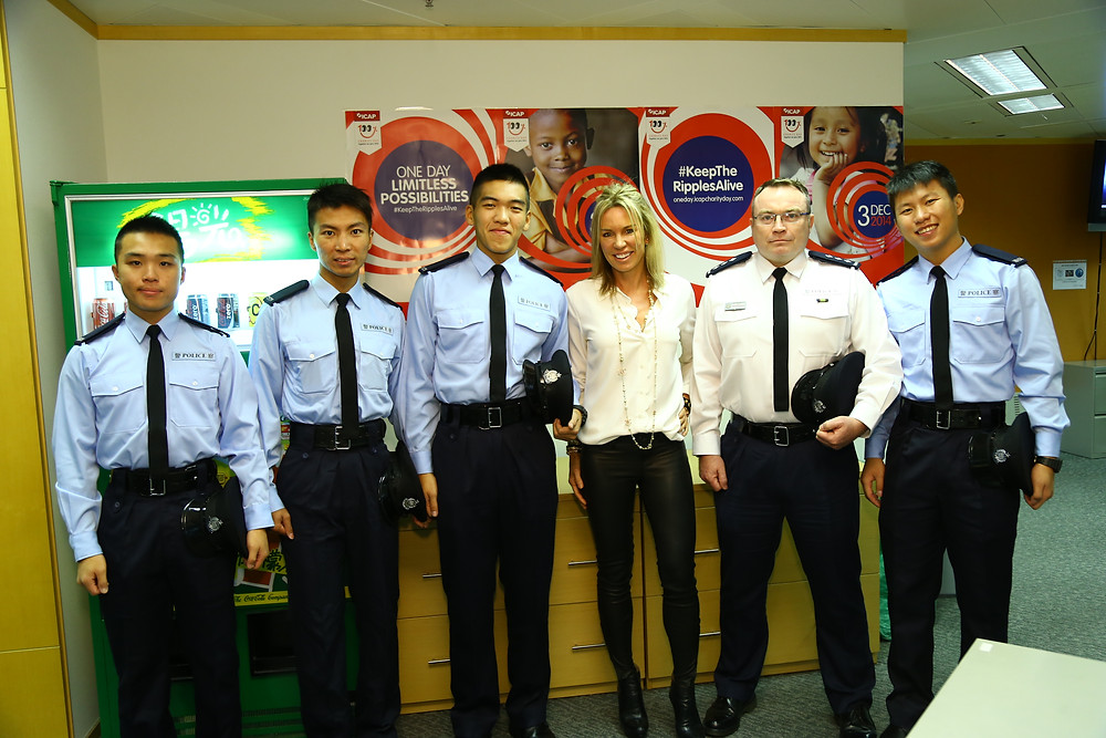 Laureus Ambassador Annabelle Bond with Breakthrough director John Carroll and serving police officers from Breakthrough.
