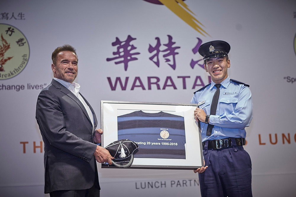 Ex-Breakthrough rugby player and now police officer Peter Yip Man Kuen presenting Mr. Arnold Schwarzenegger with a commemorative cap and framed shirt celebrating Breakthrough's 20th anniversary this year.