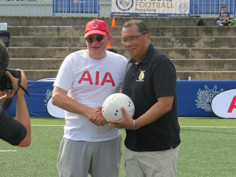 AIA CEO presents Breakthrough Director Mal Thompson with a signed football from  Tottenham Hotspur 1st team for auction and fundraising
