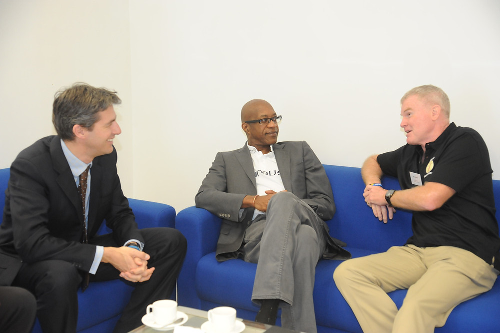 Laures Sports for Good Foundation Ned Wills, Chairmen of the Laureus World Sports Academy Dr Edwin Moses and Operation Breakthrough Executive Director Mr Barry Smith  in conversation.