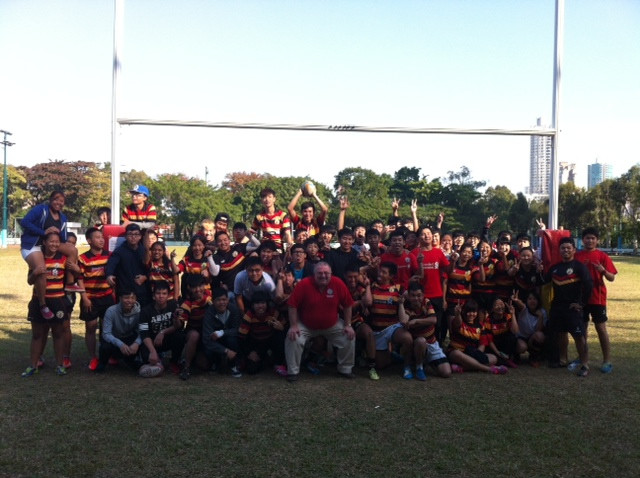 A group picture taken after a touch rugby game before Christmas Party