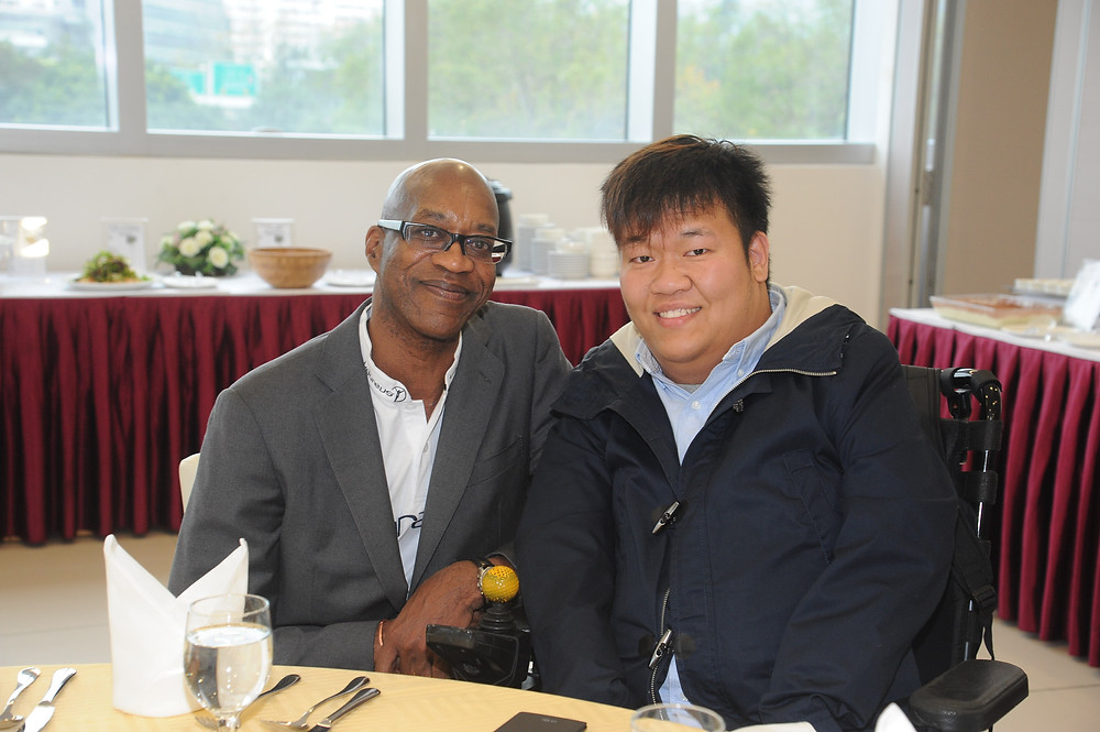 Chairmen of the Laureus World Sports Academy Dr Edwin Moses with Laureus award nominee Leung Yuk Wing.