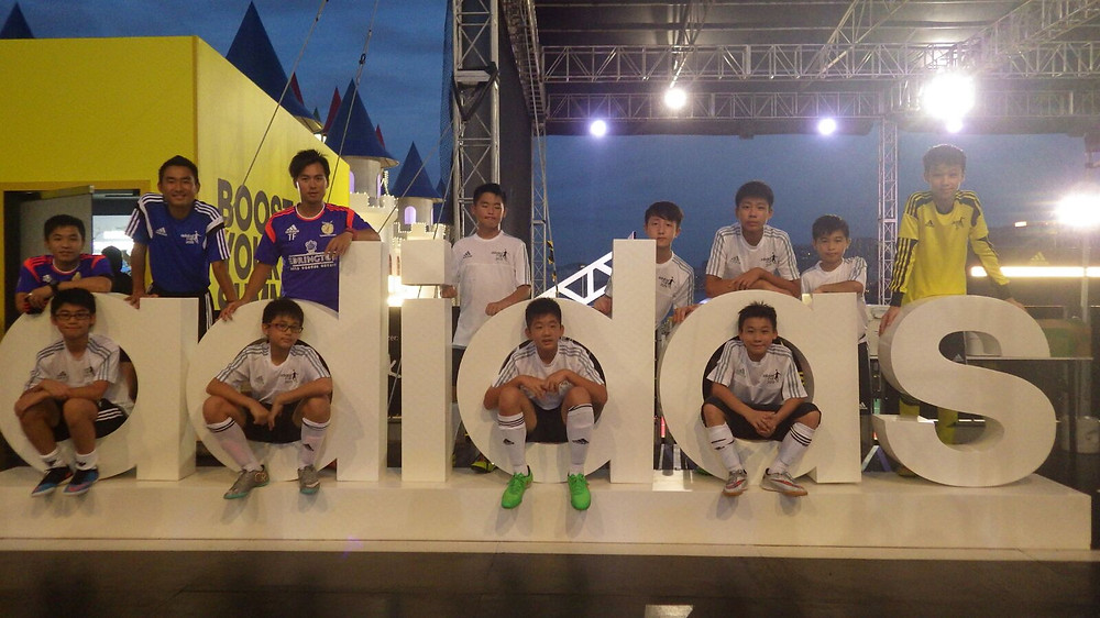 Breakthrough U14 Football players pose for a team photo with coaches Kenji and Ah Sa and Ah Wah at the Adidas Cup 2015 (Fri 10 July, 2015)